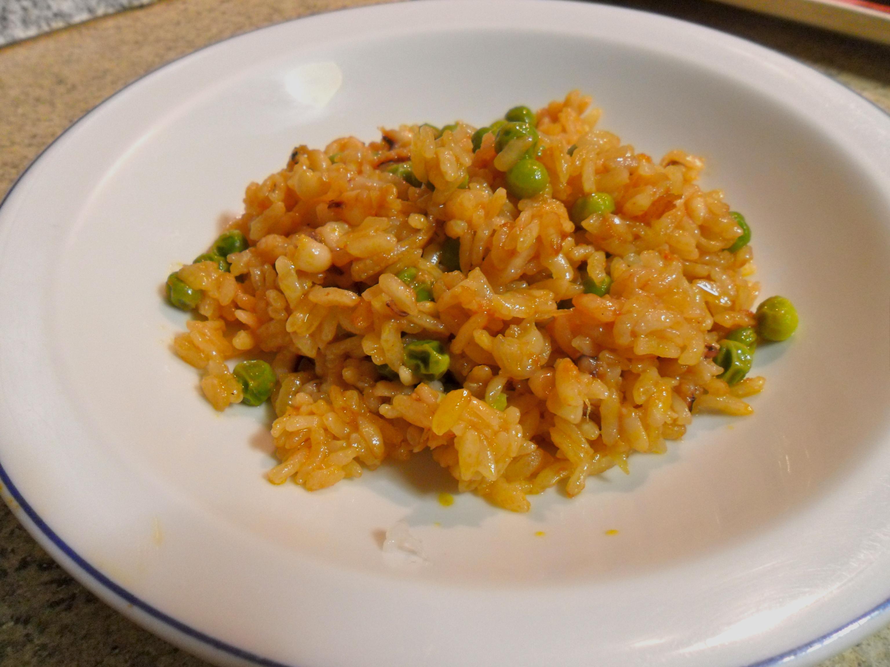 primi piatti : riso calamari e piselli